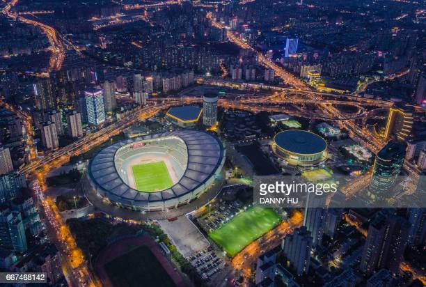 aerial view of shanghai stadium in xuhui district - stadion stockfoto's en -beelden