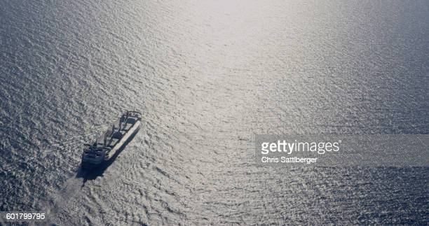 Aerial view of shipping barge in ocean