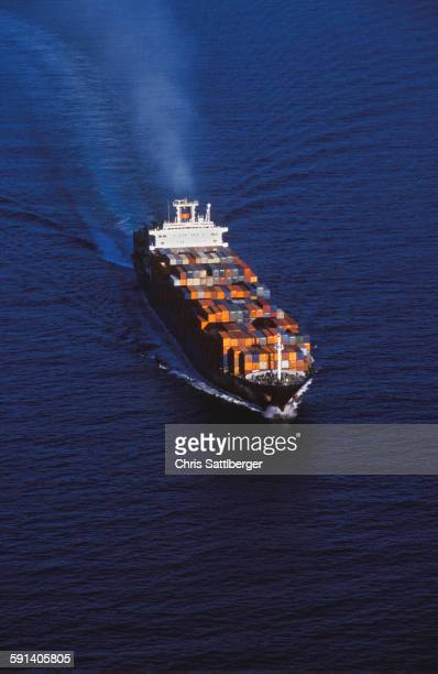 aerial view of shipping barge sailing on ocean - barge stock photos and pictures