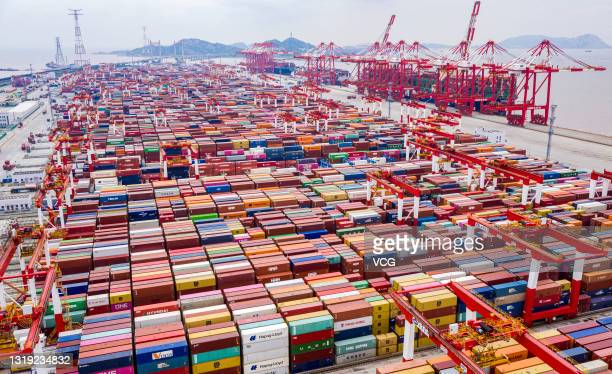 Aerial view of shipping containers sitting stacked at Yangshan Deepwater Port, the world's biggest automated container terminal, on May 21, 2021 in...