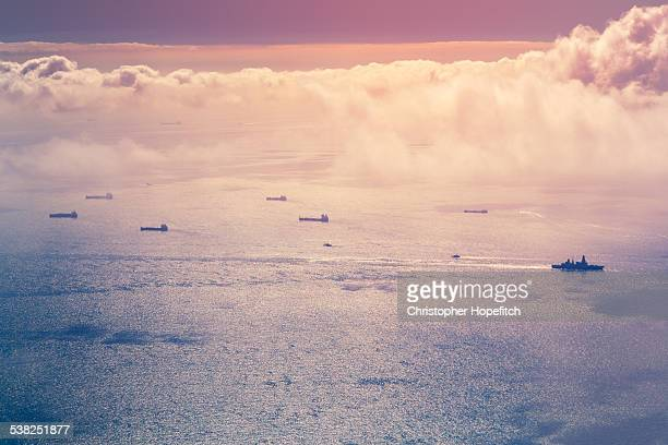 aerial view of ships at sea - warship stock pictures, royalty-free photos & images