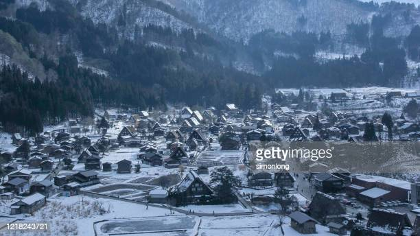 aerial view of shirakawago on winter snow in japan - satoyama scenery stock pictures, royalty-free photos & images