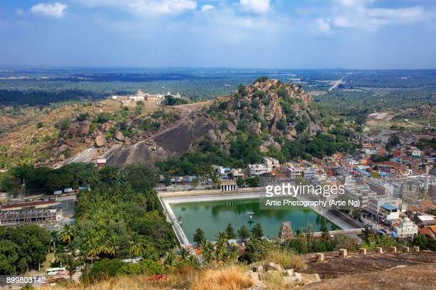 aerial view of shravanabelagola city with chandragiri temple complex on the hill in hassan, karnataka, india - sravanabelagola stock photos and pictures