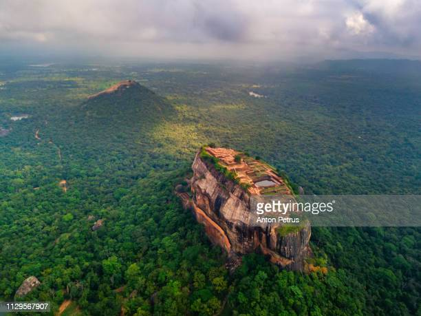 aerial view of sigiriya rock at misty morning, sri lanka. drone photo. - ancient civilization stock photos and pictures