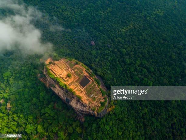 aerial view of sigiriya rock at misty morning, sri lanka. drone photo. - sri lanka stock pictures, royalty-free photos & images