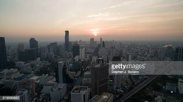 Aerial view of Silom during sunset from Lumpini Park in Bangkok,Thailand looking west.