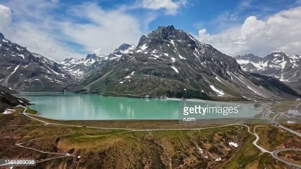 aerial view of silvretta stausee lake and silvretta-bielerhohe high alpine road in vorarlberg, austria. - vorarlberg stock pictures, royalty-free photos & images