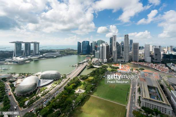 aerial view of singapore business district and city at twilight - marina bay sands stock photos and pictures