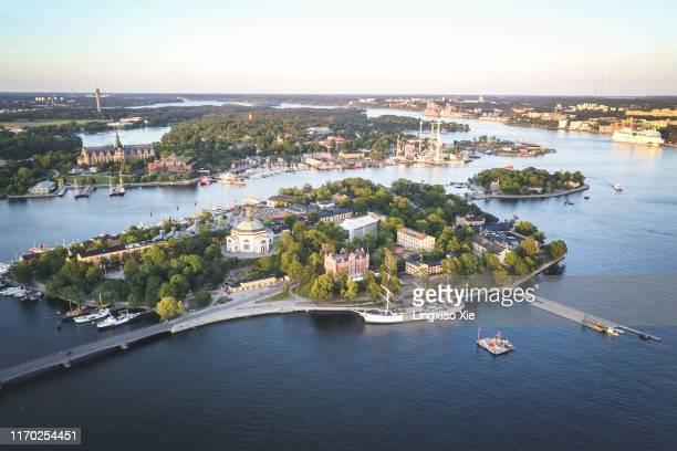 aerial view of skeppsholmen, kastellholmen and djurgården islands with stockholm city skyline at dusk, sweden - stockholm stock pictures, royalty-free photos & images