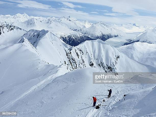 Aerial View Of Skiers On Snow Covered Mountains