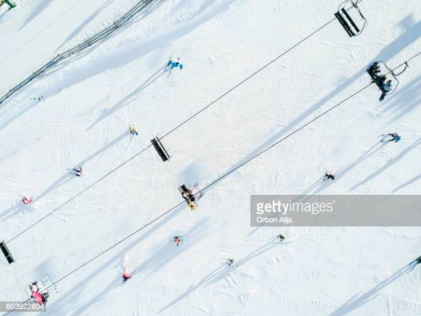 aerial view of skiers - ski lift stock pictures, royalty-free photos & images