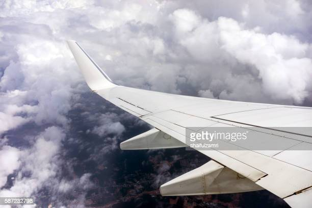 aerial view of sky from aircraft window. - shaifulzamri stock pictures, royalty-free photos & images