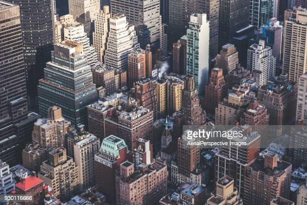 aerial view of skyscraper in midtown manhattan, nyc - times square manhattan stock-fotos und bilder