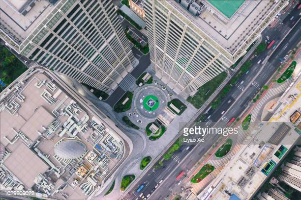 aerial view of skyscraper - overhead view of traffic on city street tokyo japan stock photos and pictures