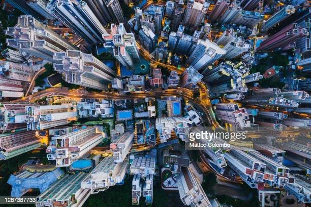 aerial view of skyscrapers and streets at dusk, hong kong - hong kong stock pictures, royalty-free photos & images