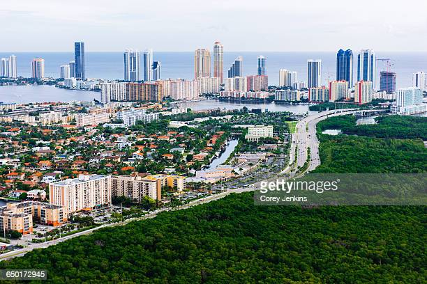 aerial view of skyscrapers and urban sprawl, aventura, miami, florida, usa - aventura stock photos and pictures