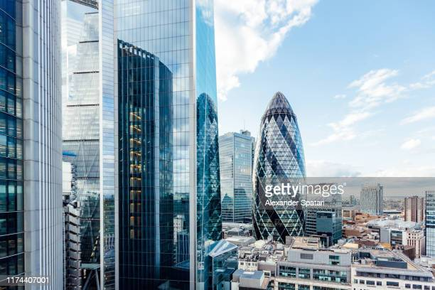 aerial view of skyscrapers in city of london, england, uk - london england stock-fotos und bilder