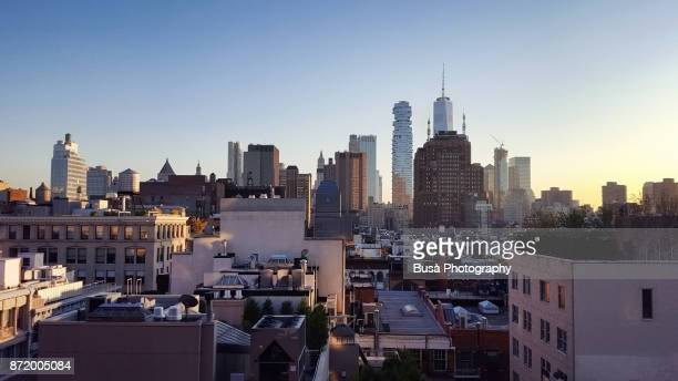 aerial view of skyscrapers in downtown manhattan, new york city - 屋根 ストックフォトと画像