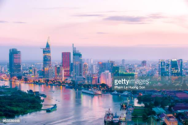 aerial view of skyscrapers in ho chi minh city at sunset, viewed from saigon river. - ベトナム ストックフォトと画像