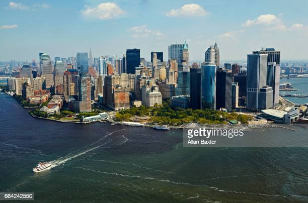 aerial view of skyscrapers in lower manhattan with ferry - parque battery fotografías e imágenes de stock