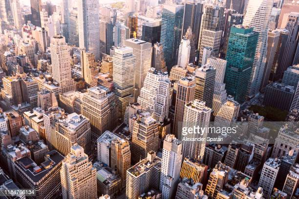 aerial view of skyscrapers in midtown manhattan, new york city, usa - new york city stockfoto's en -beelden