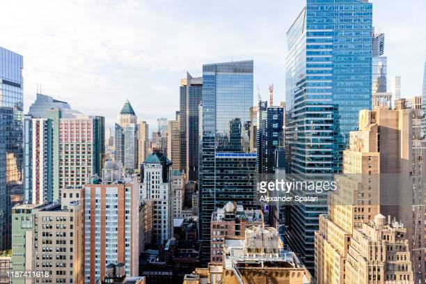 aerial view of skyscrapers in new york city, usa - skyscraper stock pictures, royalty-free photos & images