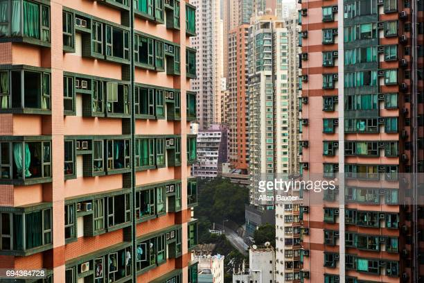 aerial view of skyscrapers in sheung wan district - cheung kong centre stock pictures, royalty-free photos & images