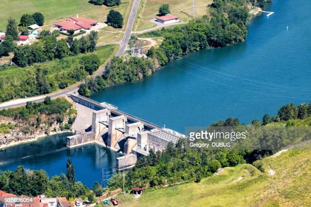 Aerial view of small hydroelectric power dam built structure on Ain river in France in summer season
