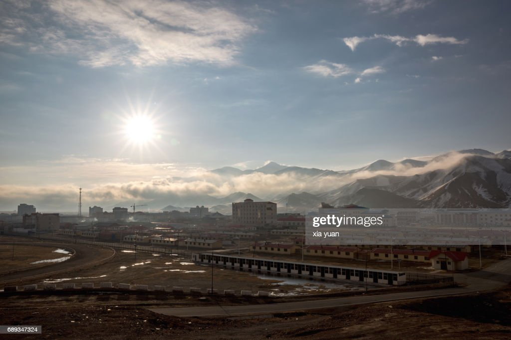 Aerial view of small town at the foot of snowcapped mountain,China : Stock Photo