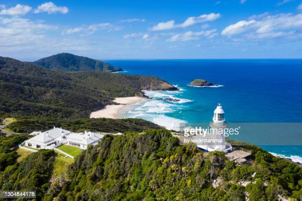 aerial view of smoky cape lighthouse and the lighthouse cottages, south west rocks, nsw, australia. - new south wales stock pictures, royalty-free photos & images