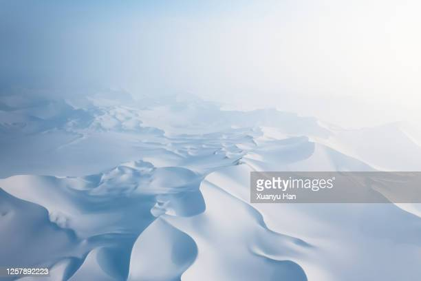 aerial view of snow covered desert sand dunes - 雪が降る ストックフォトと画像