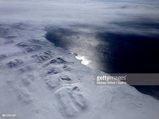 Aerial View Of Snow Covered Field And Lake