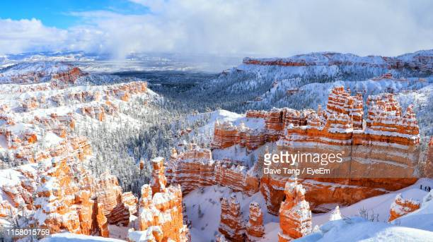 aerial view of snow covered landscape against cloudy sky - bryce canyon stock pictures, royalty-free photos & images