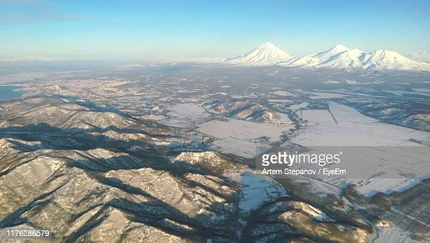 aerial view of snow covered landscape against sky - summits russia 2015 stock pictures, royalty-free photos & images