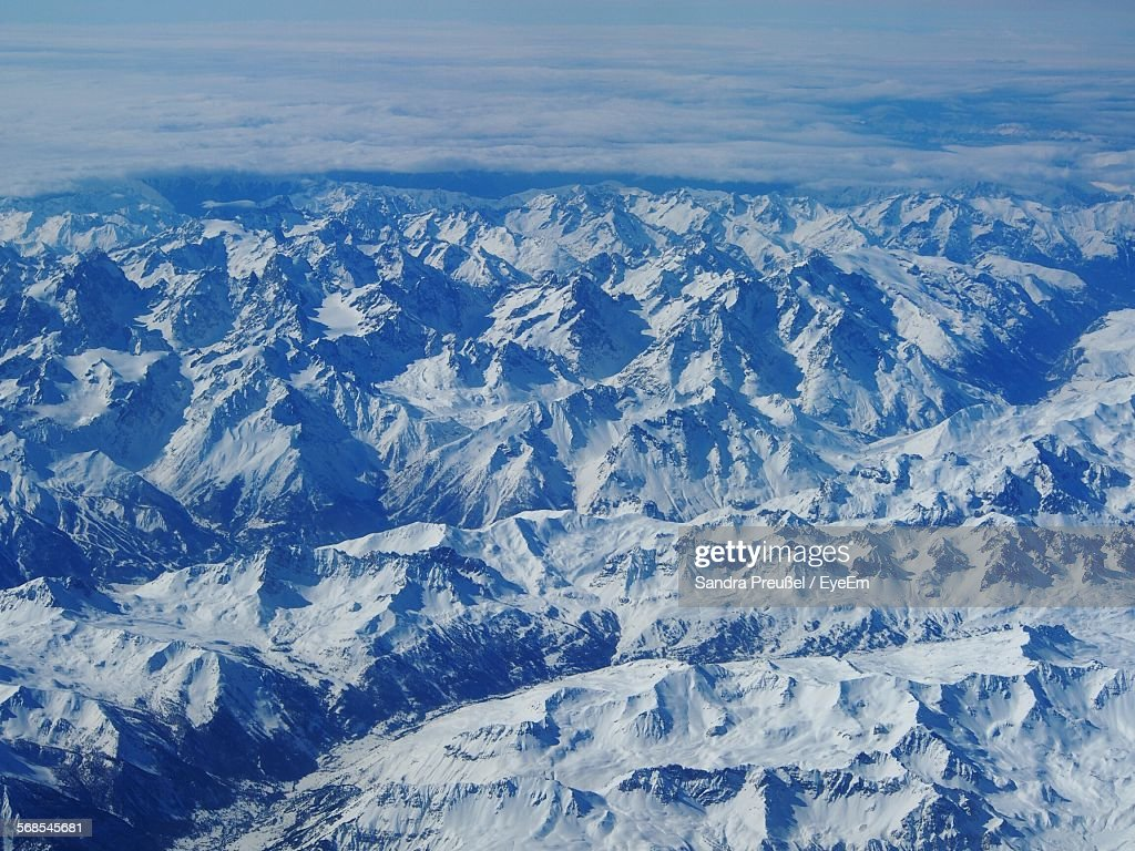 Aerial View Of Snow Covered Mountain Range : Stock Photo