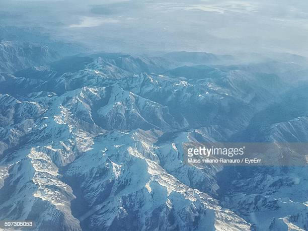 aerial view of snow covered mountains - massimiliano ranauro stock pictures, royalty-free photos & images
