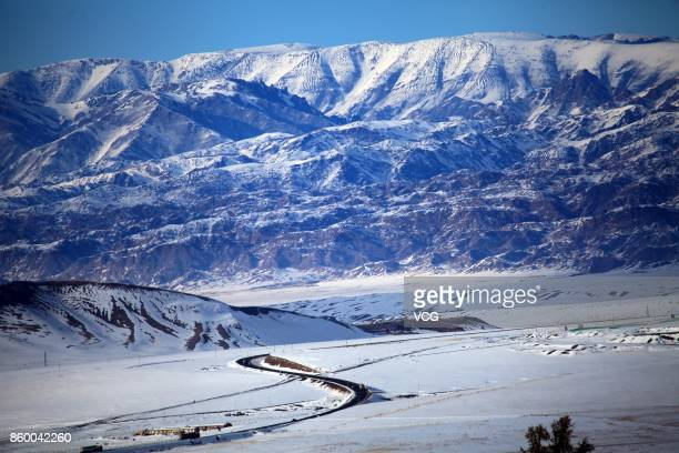 Aerial view of snow covering eastern part of the Tian Shan on October 8, 2017 in Hami, Xinjiang Uygur Autonomous Region of China. Hami welcomes its...
