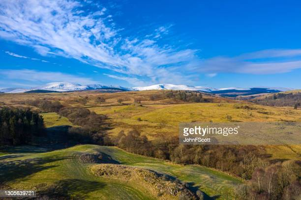 aerial view of snow on distant hills during winter - johnfscott stock pictures, royalty-free photos & images