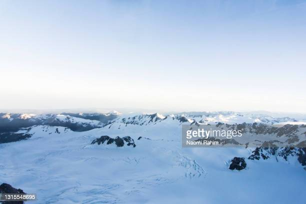 aerial view of snowcapped mountain range in the southern alps of new zealand at dawn - 2017 stock pictures, royalty-free photos & images