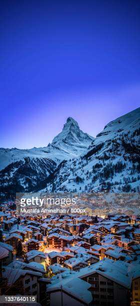 aerial view of snowcapped mountains against clear blue sky,zermatt,switzerland - zermatt stock pictures, royalty-free photos & images