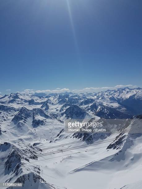 aerial view of snowcapped mountains against clear blue sky - バニェールドビゴール ストックフォトと画像