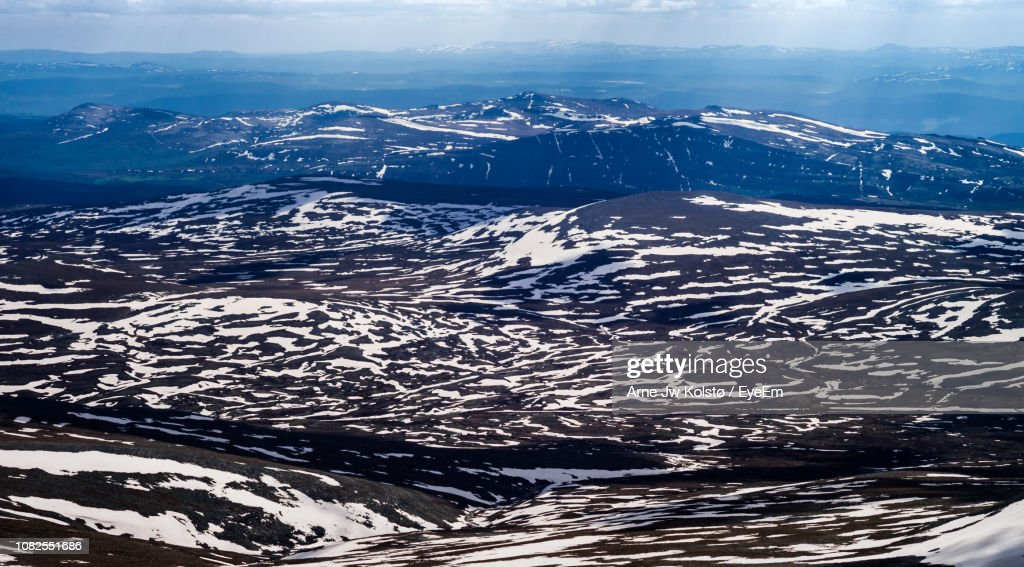 Aerial View Of Snowcapped Mountains Against Sky : Stock Photo