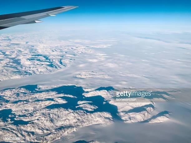 aerial view of snowcapped mountains against sky - bortes fotografías e imágenes de stock