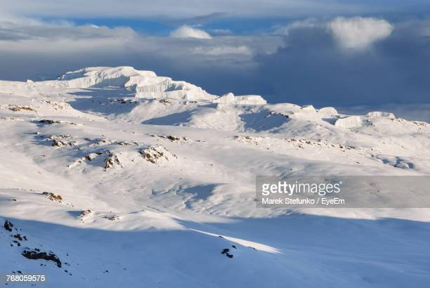 aerial view of snowcapped mountains against sky - marek stefunko stockfoto's en -beelden