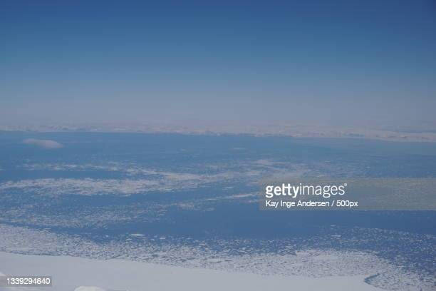 aerial view of snowcapped mountains against sky,svalbard,norway - svalbard and jan mayen stock pictures, royalty-free photos & images