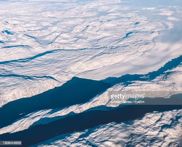 aerial view of snowcapped mountains - bortes stock-fotos und bilder