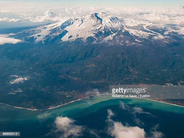 aerial view of snowcapped mt etna by sea - etna foto e immagini stock