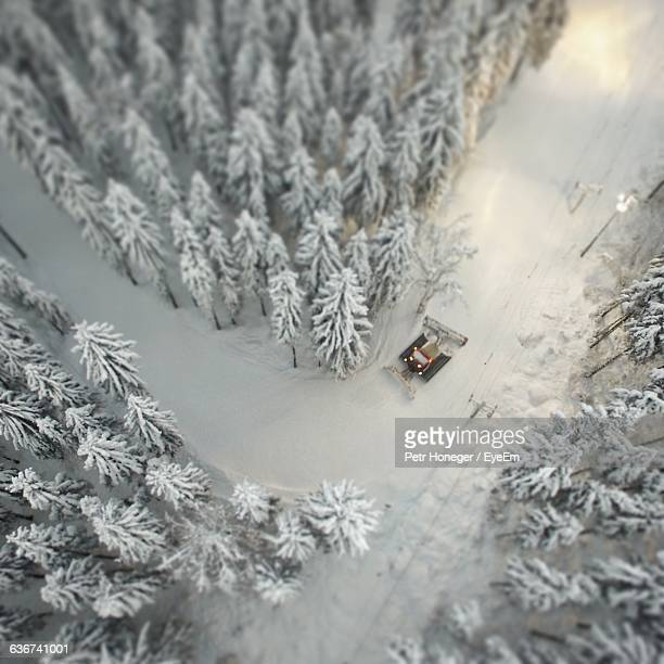 Aerial View Of Snowplow Amidst Snow Covered Trees In Forest