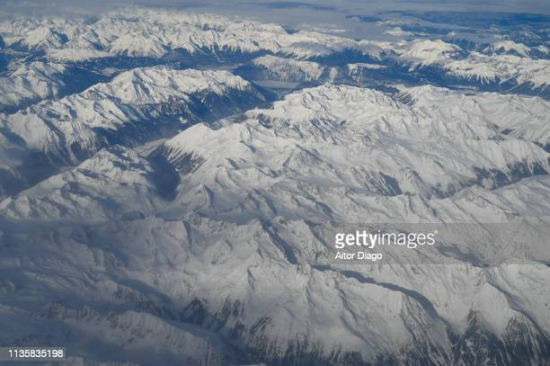 aerial view of snowy mountain range in winter - 4k resolution stock pictures, royalty-free photos & images