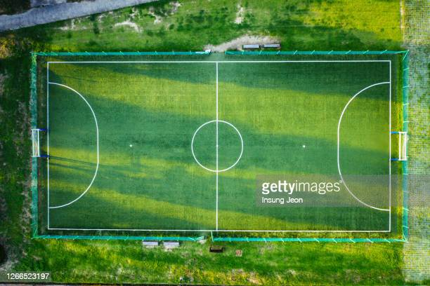 aerial view of soccer field during sunset - football pitch stock pictures, royalty-free photos & images